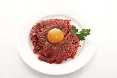 interiour: Beef Tatare with egg on plate, elevated view LANG_EVOIMAGES