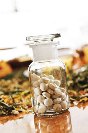 homoeopathic: Homoeopathic pills in apothecary flask, close-up