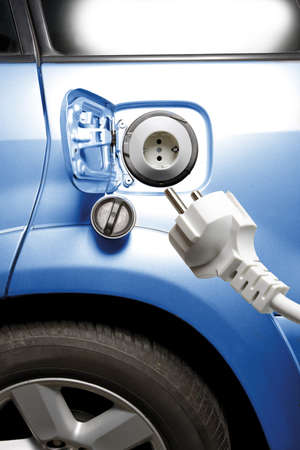 Electric plug and electric car, close-up Stock Photo - 23708023