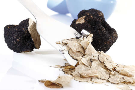 interiour shots: Black truffle being sliced, close-up