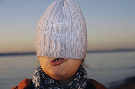 10 12 years: Girl hiding under cap