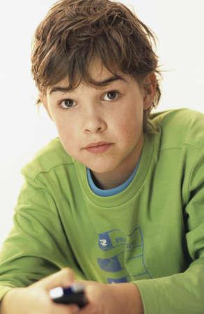 chellange: Boy (10-11) with remote control, portrait