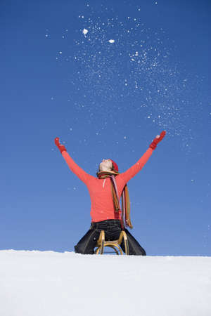 easygoing: Woman on sleigh, outdoors