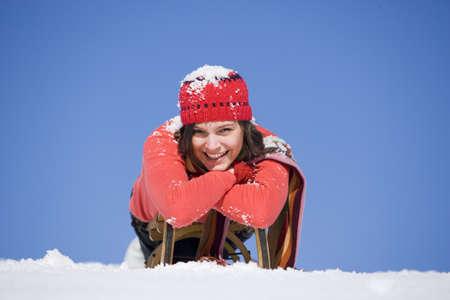 gratify: Woman with sleigh, portrait