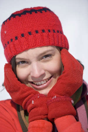 lighthearted: Woman wearing cap and gloves, portrait