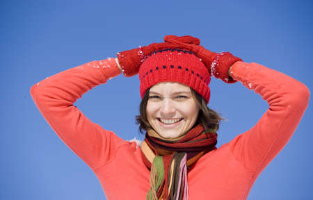 kind hearted: Woman wearing cap and gloves, portrait