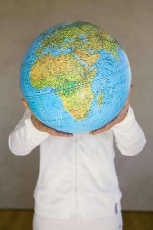 hope indoors luck: Elder lady holding globe LANG_EVOIMAGES