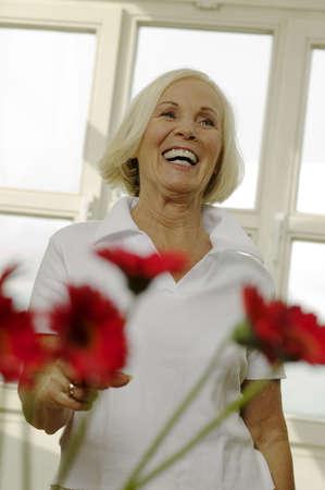 aplomb: Senior woman laughing, looking away, portrait LANG_EVOIMAGES