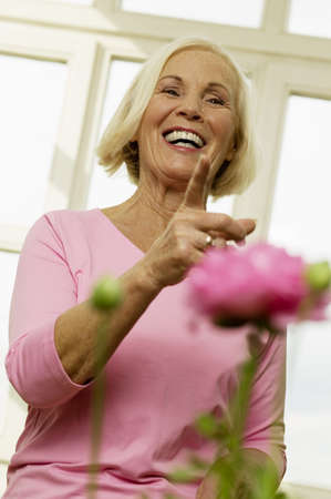aplomb: Senior woman laughing, low angle view, portrait LANG_EVOIMAGES