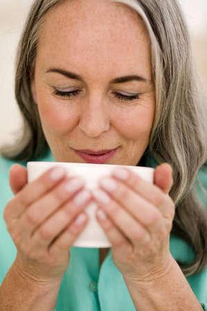 gentle dream vacation: Woman drinking tea, portrait