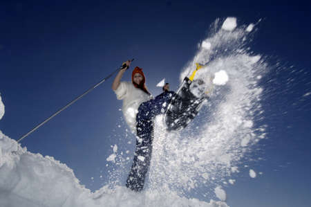snowshoeing: Woman with snow shoes, jumping
