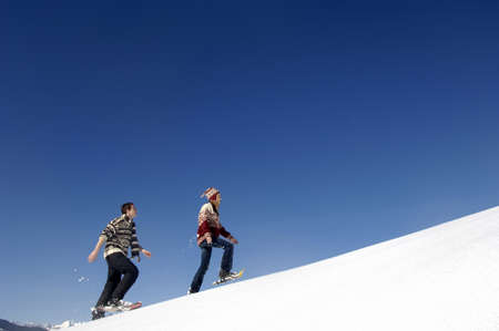 diverted: Young couple in snow, walking uphill