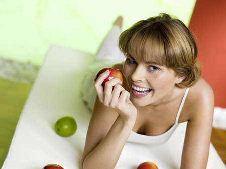 hope indoors luck: Woman lying on bed with apples
