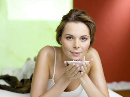 gratified: Woman lying on bed with spice in bowls