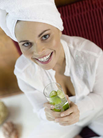 mirthful: Woman with turban drinking lime water