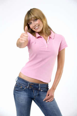 mirthful: Young woman with thumbs up LANG_EVOIMAGES