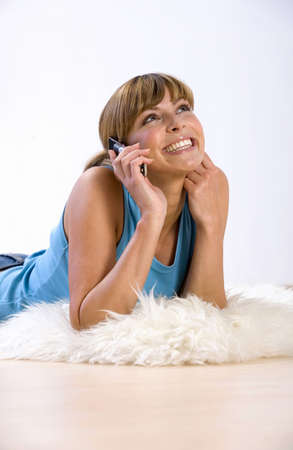 Young woman using mobile phone,smiling Stock Photo - 23818807