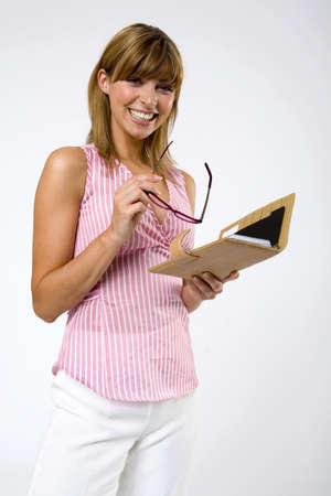 hope indoors luck: Young woman with spectacles and notebook