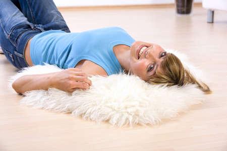 mirthful: Young woman lying on floor,portrait