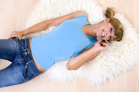 Young woman using mobile phone Stock Photo - 23852707
