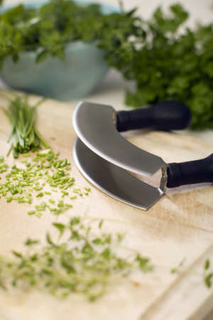 Chopped herbs and herb cutter Stock Photo - 23708078