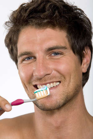 hope indoors luck: Young man holding tooth brush,portrait