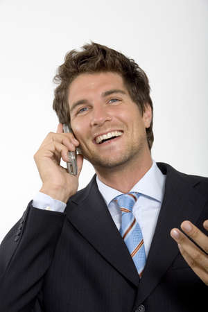hope indoors luck: Young businessman using mobile phone,smiling,close-up