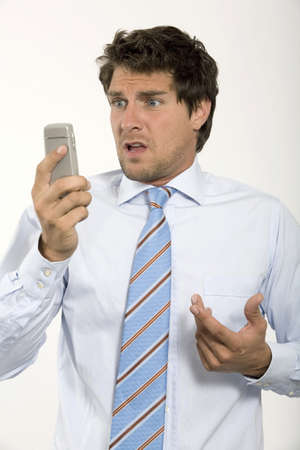 atmospheric pressure: Young businessman looking at mobile phone,close-up