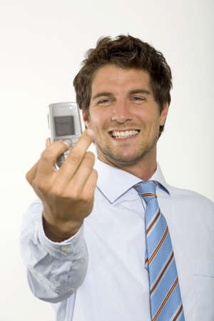 mirthful: Young businessman photographing self by mobile phone,close-up
