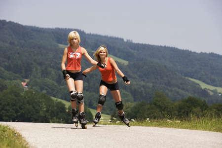diverted: Teenage girls (13-15) inline skating LANG_EVOIMAGES