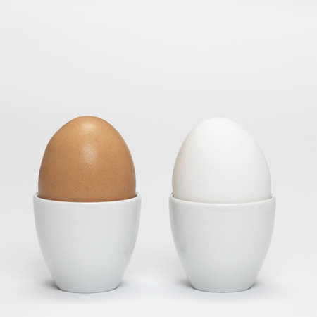 eggcup: White and brown organic eggs in eggcup