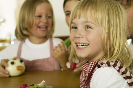kind hearted: Parents with children (2-4) playing in kitchen,smiling LANG_EVOIMAGES