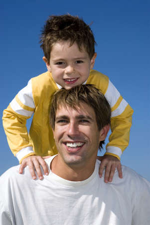 kind hearted: Boy (4-7) sitting on fathers shoulders, portrait, close-up