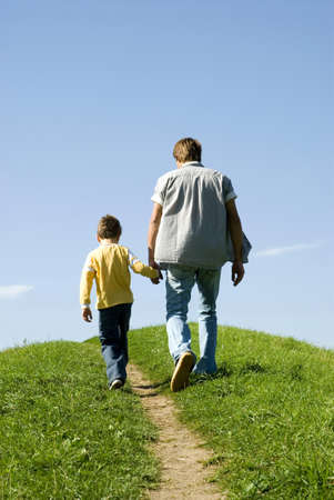 back link: Father walking hand in hand with son, rear view LANG_EVOIMAGES