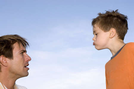 infuriate: Father and son (4-7), close-up, side view LANG_EVOIMAGES