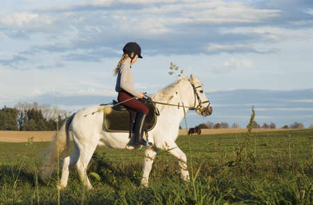 scenary: Girl riding pony