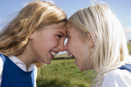 rubbing noses: Two girls nose to nose, portrait