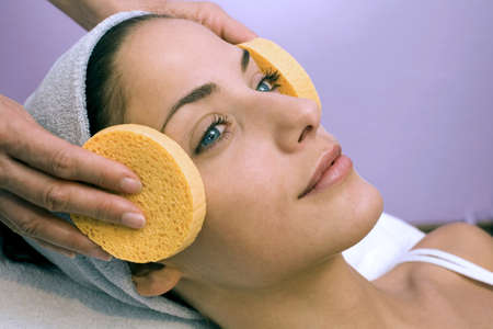 gratified: Woman receiving face treatment