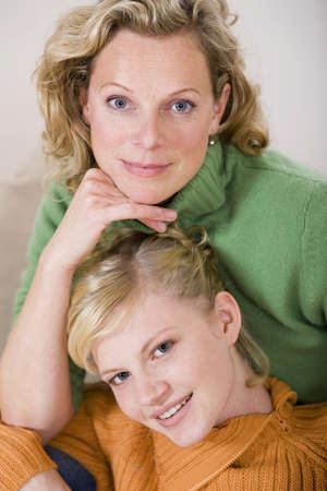 smile please: Mother with daughter smiling, portrait, close-up LANG_EVOIMAGES