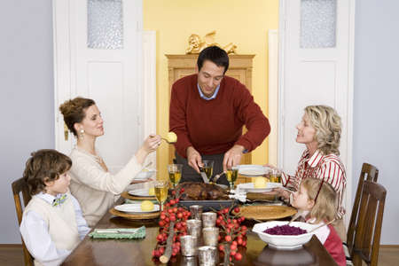table of contents: Family having Christmas dinner