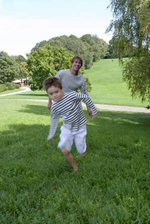 exerting: Father footracing with son (4-7)