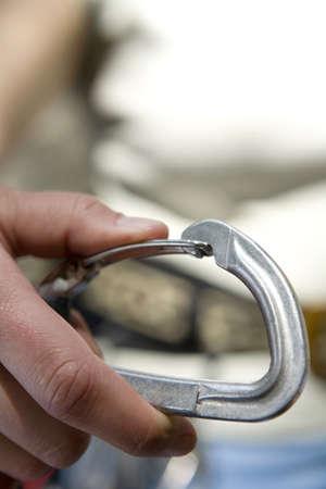 grappling: Woman holding grappling hook,close-up