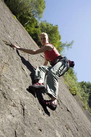 climbing  wall: Young woman climbing in climbing wall
