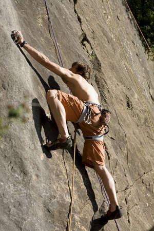 climbing  wall: Young man climbing in climbing wall