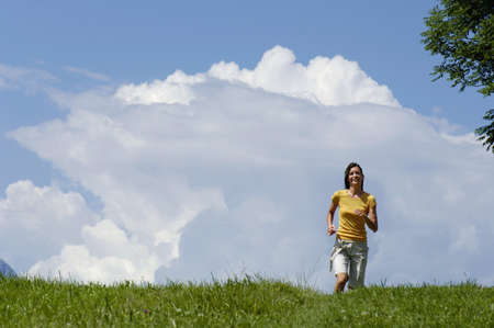 non urban 1: Young woman jogging in meadow