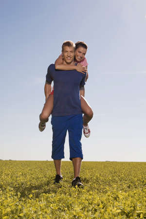 embracement: Young man carrying woman on back LANG_EVOIMAGES