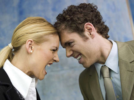 Businessman and businesswoman quarrelling, side view, close up LANG_EVOIMAGES