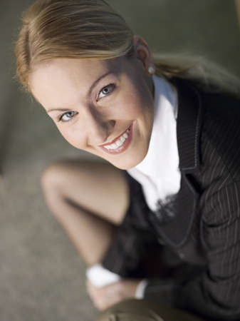 Businesswoman smiling, elevated view, portrait, close-up Stock Photo - 23853129