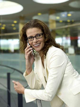 mirthful: Businesswoman using mobile phone