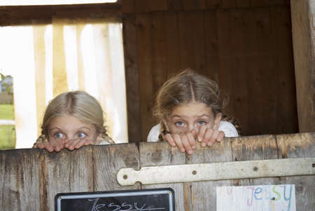 fearing: Two (8-11) girls hiding in stable LANG_EVOIMAGES